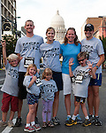 The Jennings and Hill's (Front L to R: Eli Jennings, Julia Hill, Lyla Jennings, Luke Hill, Back L to R: Adam & Katie Jennings, Kristin & Jason Hill) with the Idaho Capitol building in the background during the Main Street Mile in downtown Boise, Idaho on June 22, 2012.