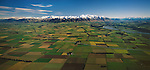 Aerial of patchwork of crops and green fields of Canterbury Plains. Mount Hutt in background. Canterbury Region. New Zealand.
