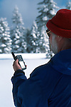 Man navigating by GPS on a winter trail