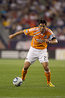 Houston Dynamo forward Brian Ching (25) dribbles. The New England Revolution defeated Houston Dynamo, 1-0, at Gillette Stadium on August 14, 2010.