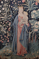 Virgin and child, from the St Eloi tapestry, Flemish, early 16th century, in Les Hospices de Beaune, or Hotel-Dieu de Beaune, a charitable almshouse and hospital for the poor, built 1443-57 by Flemish architect Jacques Wiscrer, and founded by Nicolas Rolin, chancellor of Burgundy, and his wife Guigone de Salins, in Beaune, Cote d'Or, Burgundy, France. The hospital was run by the nuns of the order of Les Soeurs Hospitalieres de Beaune, and remained a hospital until the 1970s. The building now houses the Musee de l'Histoire de la Medecine, or Museum of the History of Medicine, and is listed as a historic monument. Picture by Manuel Cohen