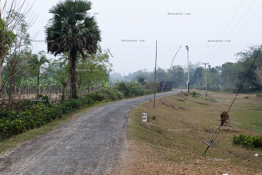 (NO BYLINE: PHOTOGRAPHED IN RESTRICTED AREAS WITHOUT GOVT. PERMISSION) The India-Bangladesh Border fence, in Nadia district, Ranaghat, North 24 Parganas, West Bengal, India, on 19th January, 2012. On the left of the fence, villagers live in the 'no mans zone'. People and products like cows are often smuggled across the porous borders by wading across the rivers and jumping the fences. Recently, a woman was shot dead by the Indian Border Security Force as she was climbing over a fence, and was left on the fence for 3 days.