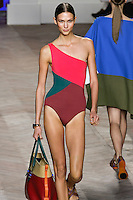 Karlie Kloss walks the runway in a pink/emerald green/merlot one-shoulder one-piece color black bathing suit, by Tommy Hilfiger for the Tommy Hilfiger Spring 2012 Pop Prep Collection, during Mercedes-Benz Fashion Week Spring 2012.
