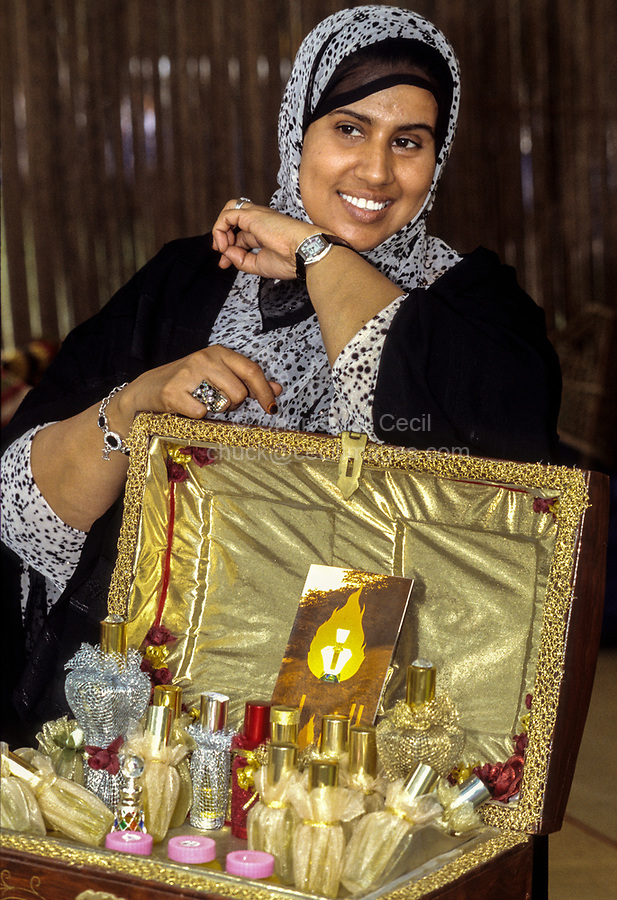 Oman.  Woman Displaying Perfumes, Oman Folklife Festival.