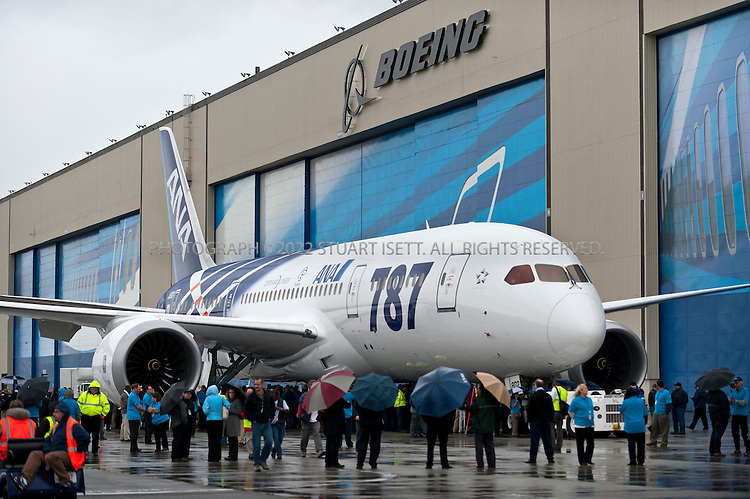 9/26/2011--Everett, WA, USA..Thousands of Boeing employees gathered in the rain to celebrate the delivery of the first 787 Dreamliner to launch customer ANA (All Nippon Airways) from Japan. The fuel efficient composite aircraft was towed to the front of the huge factory doors where it was assembled, and presented to ANA President Shinichiro Ito in front of thousands of invited dignitaries and Boeing workers. The first 787 was supposed to be delivered 3 years ago but despite delays Boeing still has orders for over 800 of the planes...©2011 Stuart Isett. All rights reserved.