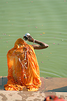 A Hindu woman takes a ritual cleansing bath at Pushkar Lake. Pushkar Lake is one of the five most sacred pilgrimage destinations for Hindus in India. On the day of the autumn full moon (Kartik Purnima), Pushkar is the holiest place in the world for Hindus.