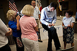 Former Minnesota Gov. Tim Pawlenty signs an autograph while campaigning for the GOP presidential nomination during a town hall event at the Iowa Farm Bureau in Des Moines, Iowa, July 20, 2011.