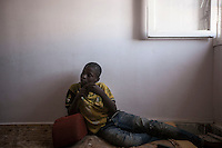 November 22, 2014 - Murzuq City, Libya: A Tebu young boy displaced from Ubari battleground is seen inside a temporary shelter outskirst Murzuq. Fighting around Southwest Ubari region ignited after Tuareg militias from Mali and Libya sized control over the vast oilfield installations aligned with the Third Force of Misrata armed forces. Since then raged battles have taken place between two factions: one faction of Tuareg fighters lead by Third Force from Misrata pushing to clean the region from the other faction of Tebu tribal fighters defending their controlled territory. (Photo/Narciso Contreras)