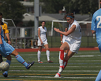 Boston Aztec midfielder/defender Morgan Andrews (10) takes a shot. In a Women's Premier Soccer League (WPSL) match, Boston Aztec (white) defeated Seacoast United Mariners (blue), 2-1, at North Reading High School Stadium on Arthur J. Kenney Athletic Field on on June 23, 2013. Due to injuries through the season, Seacoast United Mariners could only field 10 players.