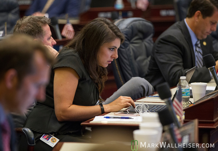 Rep. Jennifer Sullivan, R- Mount Dora, works during Florida House of Representatives floor debate at the Florida Capitol in Tallahassee, Florida.