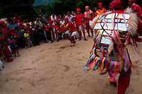 "The Devils (Diablos) dance performing a fictious fight during the religious procession in Atanquez, Sierra Nevada, Colombia, 3 June 2010. A colorful celebration of Corpus Christi is held in the Kankuamo Indians territory every year. ""The Dance of the Devils"" is an ancient tradition kept for centuries on the Colombia's Caribbean coast. This Christian religious event usually coincides with the summer solstice, which has always been the key point for the native cultures and for the black African slaves. Due to this confluence, the Kankuamo myths, the African animistic rites and other Pre-Columbian features have blended with the Spanish Catholic festival into a lively spectacle."