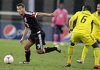 WASHINGTON, DC - OCTOBER 20, 2012:  Hamdi Salihi (9) of D.C United pushes the ball away from Tony Tchani (6) of the Columbus Crew during an MLS match at RFK Stadium in Washington D.C. on October 20. D.C United won 3-2.