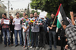 Palestinian protesters hold placards during a demonstration in front of United Nation building in Gaza City to mark the anniversary of the Balfour Declaration on October 31, 2013. The 1917 Balfour Declaration is a formal statement of policy by the British government regarding the establishment of a Jewish homeland in Palestine. Photo by Ashraf Amra