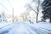 Kids play in the snow on Tuesday, December 6, 2011 in Webster City, IA.