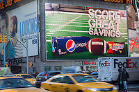 A Walgreen's in Times Square in New York promotes soda and snacks for the Super Bowl  on Friday, January 24, 2014. Despite the game being held in New Jersey on February 2 sports fans are expected to pack New York to take part in the multitude of activities planned around the game. Security is expected to reach unprecedented levels and the NYPD has installed approximately 200 temporary surveillance cameras, in addition to the multitude they already have in place,  in the 13 block length on Broadway that will host the street fair for the week prior to the game. (© Richard B. Levine)