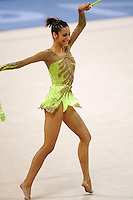 Almudena Cid of Spain dance (after fouette turns) with clubs at 2004 Athens Olympic Games during All-Around final on August 29, 2006 at Athens, Greece. (Photo by Tom Theobald)