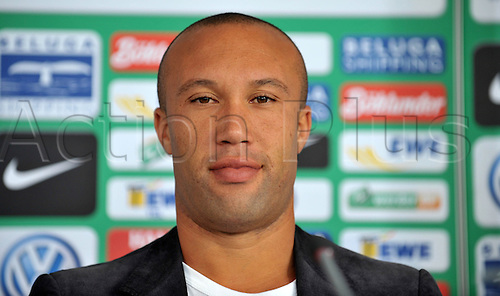 30.08.2010 German Bundesliga club SVWerder Bremen's new signed Mikael Silvestre smiles upon his presentation in Bremen, Germany, 30 August 2010. Bremen signed the 33-year-old defender from English side Arsenal on a free transfer.