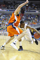 Kemba Walker of the Huskies tries to get around his opponent. Connecticut defeated Bucknell 81-52 during the NCAA tournament at the Verizon Center in Washington, D.C. on Thursday, March 17, 2011. Alan P. Santos/DC Sports Box