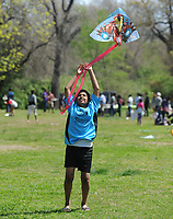 NWA Democrat-Gazette/ANDY SHUPE<br /> Taksh Patel, 12, of Fayetteville laughs Saturday, April 8, 2017, as he helps his father, Yogesh Patel, to get a kite aloft during a celebration of Vasant Utsav for University of Arkansas students in Wilson Park in Fayetteville. The traditional Hindu celebration marks the coming of spring and offers a break from studying to students so they can revere Saraswati, the goddess of knowledge and learning.