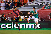 Edgar Castillo (2) of the United States and Pablo Barrera (7) of Mexico. The men's national teams of the United States (USA) and Mexico (MEX) played to a 1-1 tie during an international friendly at Lincoln Financial Field in Philadelphia, PA, on August 10, 2011.