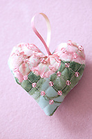 A close up of a handmade heart-shaped Christmas decoration