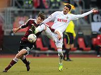 FUSSBALL   1. BUNDESLIGA  SAISON 2011/2012   22. Spieltag 1 FC Nuernberg - 1. FC Koeln       18.02.2012 Philipp Wollscheid (li, 1 FC Nuernberg) gegen Milivoje Novakovic (1. FC Koeln)
