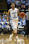 """05 January 2015: North Carolina's Marcus Paige. UNC players and coaches honored late UNC alumnus and ESPN broadcaster Stuart Scott by wearing a patch reading """"STU"""" during the game. The University of North Carolina Tar Heels played the University of Notre Dame Fighting Irish in an NCAA Division I Men's basketball game at the Dean E. Smith Center in Chapel Hill, North Carolina."""