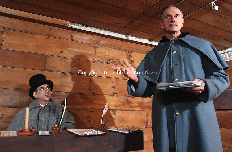 Litchfield, CT-022708MK06 From Right, Leigh Loveday, as United States Attorney William S. Holabrid, delivers arguments as Peter Tavino, playing the judge, and member of the Board of Directors, listens  during a mock trial of the Amistad slave revolt at the Tapping Reeve Law School museum and Historical Society in Litchfield recently.  The presentation provided a forum for a discussion on issues that arose in the case and how the ruling affected the course of American history. Michael Kabelka / Republican-(rom Right, Leigh Loveday, as United States Attorney William S. Holabrid, delivers arguments as Peter Tavino, playing the judge, and member of the Board of Directors )CQ