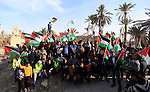 "Palestinian and foreign activists hold Palestinian flags at the site of the old village known as Ein Hijleh, in the Jordan valley near the West Bank City of Jericho, January 31, 2014. Hundreds of Palestinians announced today the launching of ""Melh Al-Ard"" (Salt of the Earth) campaign by reviving the village of Ein Hijleh in the Jordan Valley on land belonging to the Orthodox Church and St. Gerassimos monastery. The campaign is launched in refusal of Israeli policies aimed at Judaizing and annexing the Jordan Valley. Photo by Issam Rimawi"