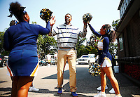 Cheerleaders from the Jalen Rose Leadership Academy charter school welcome Jalen Rose to the 5th annual Jalen Rose Leadership Academy golf tournament at the Detroit Golf Club in Detroit, Michigan on Monday August 31, 2015. (Photo by Jared Wickerham/The Players Tribune)