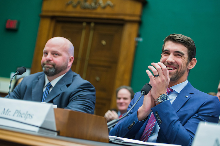 UNITED STATES - FEBRUARY 28: Olympic gold medalists Michael Phelps, right, and Adam Nelson, testify during a House Energy and Commerce Subcommittee on Oversight and Investigations hearing in Rayburn Building on ways to strengthen the international anti-doping system, February 28, 2017. Phelps is a swimmer and Nelson a shot putter. (Photo By Tom Williams/CQ Roll Call)