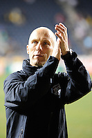 United States (USA) head coach Bob Bradley salutes the fans aftder the game. The men's national teams of the United States (USA) and Colombia (COL) played to a 0-0 tie during an international friendly at PPL Park in Chester, PA, on October 12, 2010.