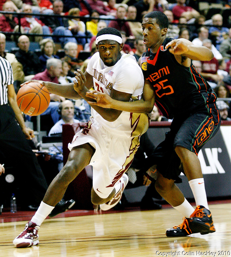 TALLAHASSEE, FL 2/6/10-FSU-MIAMI BB10 CH11-Florida State's Michael Snaer drives by Miami's Garrius Adams during first half action Saturday at the Donald L. Tucker Center in Tallahassee...COLIN HACKLEY PHOTO