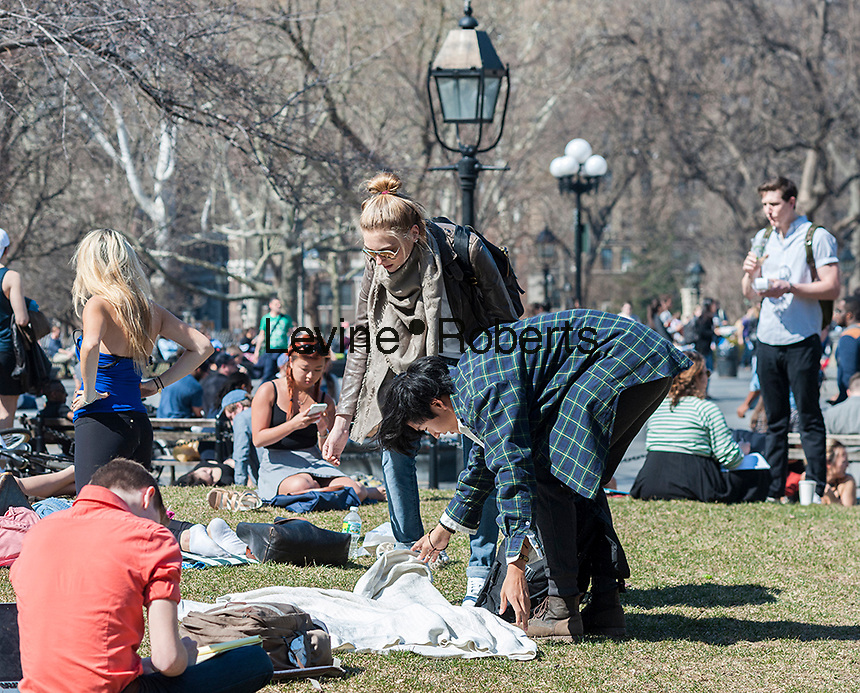 Visitors to Washington Square Park in New York enjoy the unseasonably warm weather on Wednesday, March 9, 2016.  Temperatures in the city broke a 16 year record climbing to a high of 77 degrees.  (© Richard B. Levine)