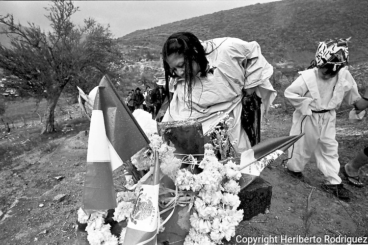 Native Nauas neighbors atend the festivity of the Day of the Holy Cross in Acatlan town in southern state of Guerrero, May 3, 2004. The Nauas people of Acatlan town are mostly immigrant workers in some Mexican states as Morelos, Hidalgo, Sonora, Sinaloa and Baja California states where they spend almost nine months a year in harvest work. Photo by Heriberto Rodriguez