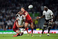 Leone Nakarawa of Fiji offloads the ball after being double-tackled. Rugby World Cup Pool A match between England and Fiji on September 18, 2015 at Twickenham Stadium in London, England. Photo by: Patrick Khachfe / Onside Images