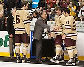 Jerry York (BC - Head Coach), Patrick Wey (BC - 6), Steve Nazro, Pat Mullane (BC - 11), Steven Whitney (BC - 21) - The Boston College Eagles defeated the Northeastern University Huskies 6-3 on Monday, February 11, 2013, at TD Garden in Boston, Massachusetts.