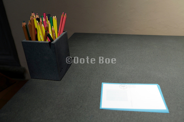pencils and blank paper laying on table