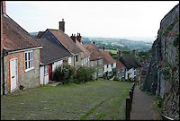 BNPS.co.uk (01202 558833)<br /> Pic: RachelAdams/BNPS<br /> <br /> A cottage immortalised in the famous Hovis TV advert featuring a young boy struggling to push his bike up a steep cobbled street is up for sale.<br /> <br /> The bungalow at Gold Hill, Shaftesbury, Dorset, was the home of 'Old Ma Peggotty' in the ad - the last house on the bakery boy's round.<br /> <br /> The 1973 commercial, directed by Ridley Scott, was voted Britain's all-time favourite TV advert in 2006.<br /> <br /> In it the lad is heard to say that delivering bread to the house on top of the hill 't'was like taking bread to the top of the world.'