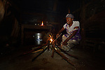 Cebonet Alcide lights a fire as she begins to prepare breakfast in the predawn darkness in Despagne, an isolated village in southern Haiti where the Lutheran World Federation has been working with residents to improve their quality of life.