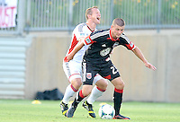 Perry Kitchen (23) of D.C. United shield the ball against chad Barrett (9) of the New England Revolution. D.C. United defeated the The New England Revolution 3-1 in the Quarterfinals of Lamar Hunt U.S. Open Cup, at the Maryland SoccerPlex, Tuesday June 26 , 2013.