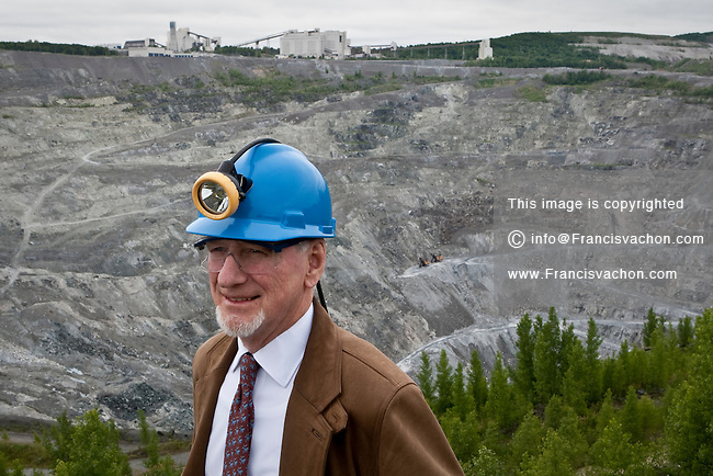 Bernard Coulombe, CEO of Mine Jeffrey Asbestos Mine, poses near his mine's open pit in the town of Asbestos, Quebec, Thursday June 30, 2011. Coulombe is fighting to prevent the labelling of asbestos as a harmful substance.