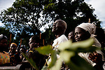 Gabriel Makana's father cries at his sons funeral after he was ambushed by the LRA and his body mutilated.
