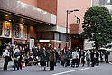 March 11, 2011, Tokyo, Japan - Shoppers, store keepers and office workers ran out of buildings to the street in Tokyo's Ginza shopping district as the nation capital is shook by aftereffects of Friday's powerful earthquake that struck Japan's northern area on March 11, 2011.  The quake with a magnitude of 8.9 hit Miyagi prefecture, causing damages in northern Japan. (Photo by Akihiro Sugimoto/AFLO) [1080] -mis-