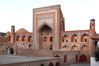 General view of the Allah Kuli Khan Madrasah, 1834-35, Khiva, Uzbekistan, pictured on July 7, 2010, in the afternoon. The Allah Kuli Khan Madrasah, second largest college in the city, has the highest portal in Khiva. Parts of the city wall and adjoining Khojamberdiby Madrasah were demolished to allow space for the 99 celled building. Khiva, ancient and remote, is the most intact Silk Road city. Ichan Kala, its old town, was the first site in Uzbekistan to become a World Heritage Site(1991). Picture by Manuel Cohen.