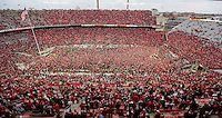 Fans crowd the field after Ohio State beat Michigan 30-27 in double overtime during the NCAA football game between the Ohio State Buckeyes and the Michigan Wolverines at Ohio Stadium on Saturday, November 26, 2016. (Columbus Dispatch photo by Jonathan Quilter)