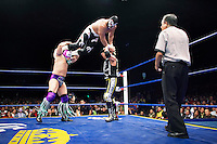 Luchadores (fighters) do their thing. Lucha Libre is a style of wrestling started in Mexico in 1933. The name means Free Fight, and matches tend to be focussed on spectacle and theatre with fans cheering for their favourite characters, who wear masks while jumping from the ropes, flipping opponents, and occasionally crashing into the crowd..&copy;Jacob Silberberg/Panos/Felix Features.