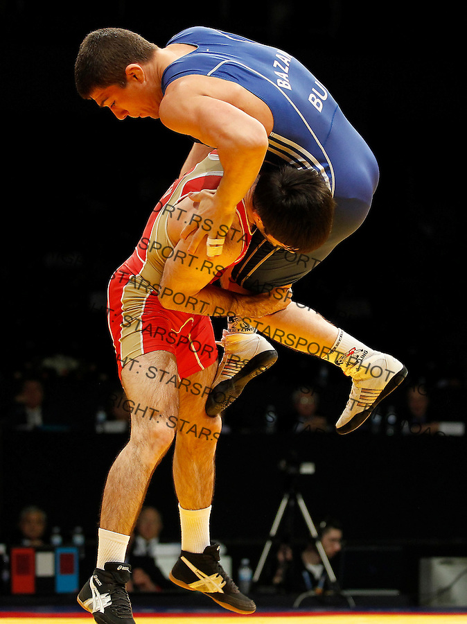 BELGRADE, SERBIA - MARCH 06: Alan Gogaev of Russia (L) competes for the gold medal  with Leonid Bazan (R) of Men's Freestyle 66kg during the European wrestling championship March 06, 2011 in Belgrade, Serbia.(Photo by Srdjan Stevanovic/Getty Images)