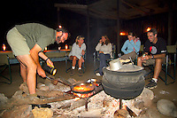 KLASERIE PRIVATE GAME RESERVE, SOUTH AFRICA, DECEMBER 2004. Gary cooks the steak to perfection while the hot water for the shower stays warm in the big pot. Wildlife guide Gary Freeman takes people on walking safaris in the bush. Photo by Frits Meyst/Adventure4ever.com