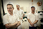 Pizza chefs in the kitchen of Antica Pizzeria de Michele, Naples, Italy.